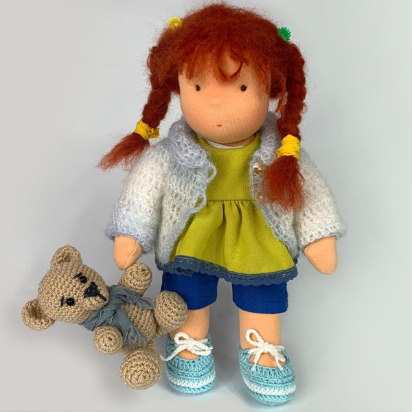 Cute doll with red hair and crocheted bear