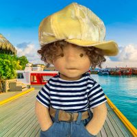 Cute Waldorf inspired boy doll with yellow hat, t-shirt, jacket, jeans, belt and handmade leather shoes