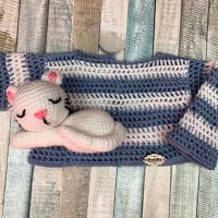 Crocheted sweater for doll