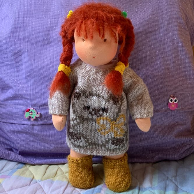 Steiner doll with red hair and crocheted sweater