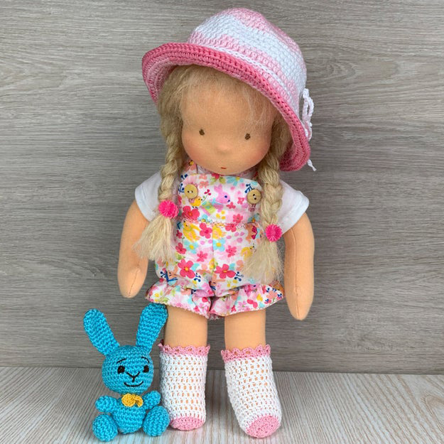 Waldorf doll with crocheted hat